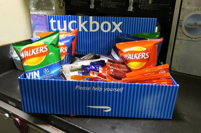 The self serve snack box in the galley contained a large variety of snack items.