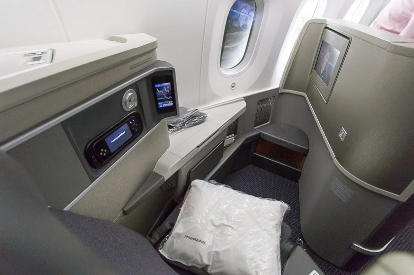 While these seats are a little less private than reverse-herringbone seats, your feet area isn't under the seat in front of you, so it feels more open.