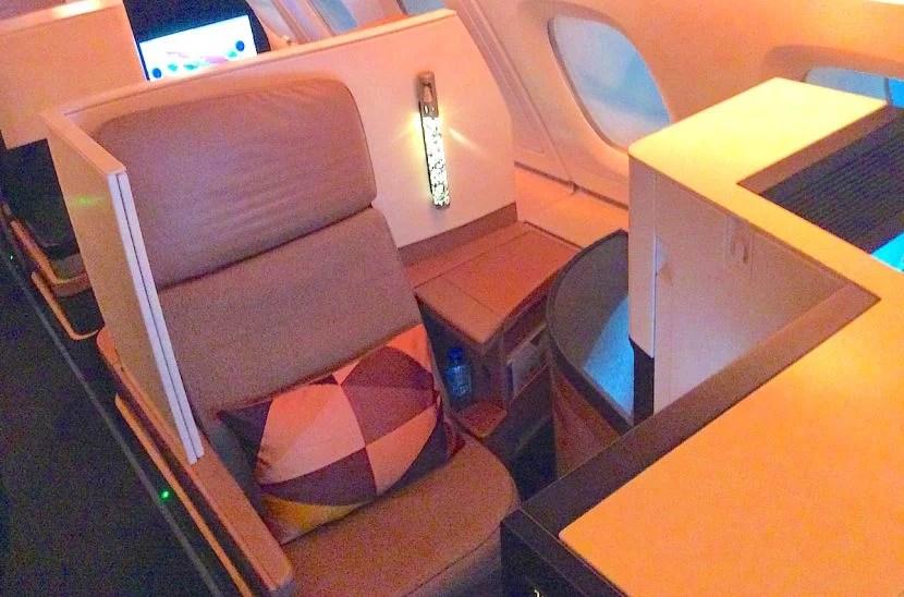 I originally had a rear-facing seat with a narrow aisle armrest.