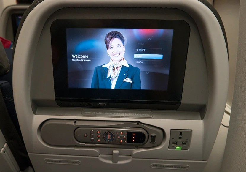 The IFE screen sported a conveniently-located AC outlet.