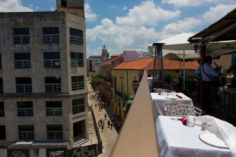 Check out the rooftops of Old Havana from La Moneda while enjoying live music.