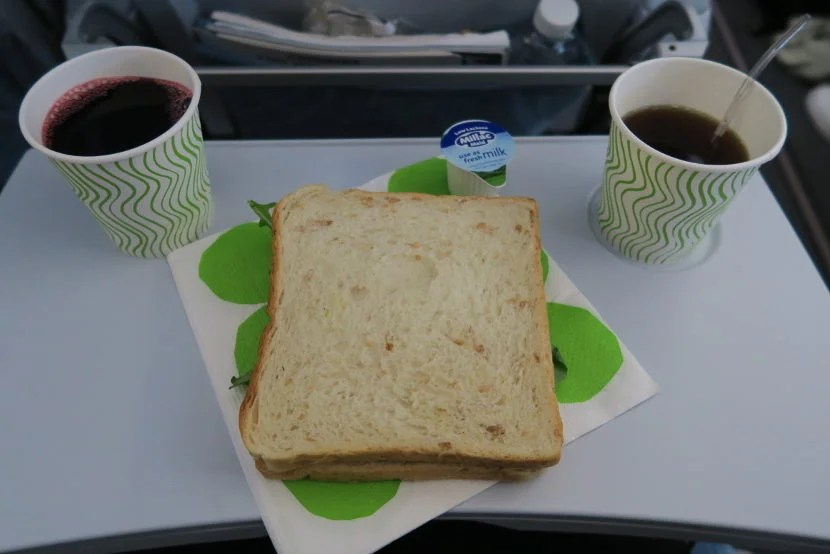 The arrival meal was a chicken salad sandwich with juice and coffee or tea.