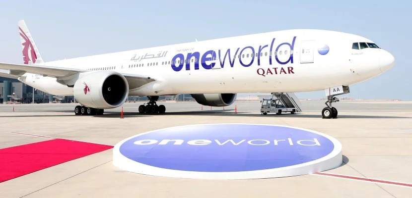 Qatar aircraft in oneworld livery on tarmac in front of orb, red carpet featured 830x400
