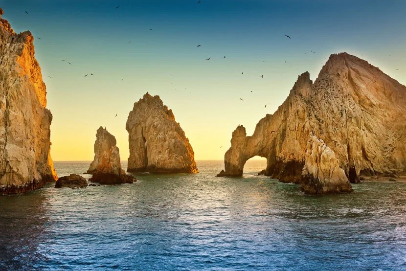 "Cliffs near Cabo: Image Courtesy of <a href=""http://www.shutterstock.com/pic-162710642/stock-photo-natural-rock-formation-at-land-s-end-in-cabo-san-lucas-mexico.html?src=5phHcJ2LkoHX5wy_RgFF1w-1-1"" target=""_blank"">Shutterstock</a>."