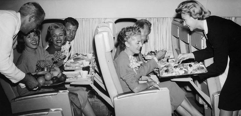 People on a plane. Image courtesy of Wikimedia Commons.