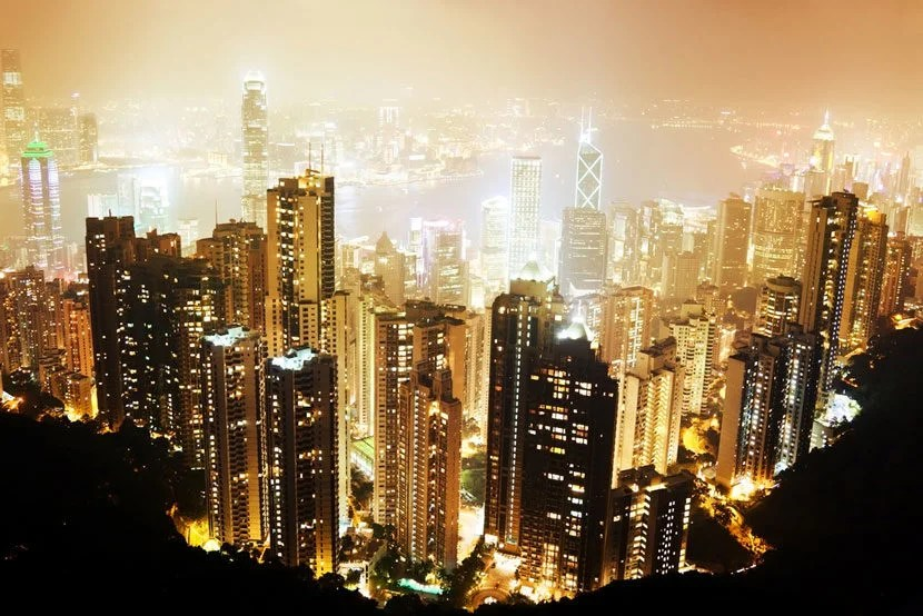 """The Peak's view is best enjoyed after dark. Image courtesy of <a href=""""http://www.shutterstock.com/pic-96902965/stock-photo-hong-kong-island-from-victorias-peak-at-night.html?src=siFGwGpD1TPTBqDdtihXjg-1-22"""">Shutterstock</a>."""