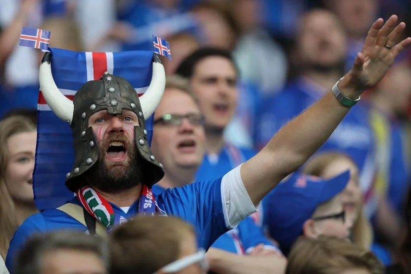 """An Icelandic football fan supports his team during the Euros. Image courtesy of <a href=""""http://www.shutterstock.com/pic-437238130/stock-photo-saint-etienne-francejune-2016-fans-and-supporterson-the-stands-in-football-match-of-euro-2016-in-france-between-portugal-vs-iceland-at-the-stade-geoffroy-guichard-on-june-142016-in-sa.html?src=jxYYhQlh2shfh4pGPliEhQ-1-67"""">Shutterstock</a>."""