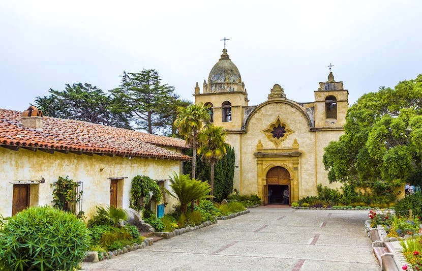"Visit the San Carlos Borromeo de Carmelo Mission for its beauty and its history. Image courtesy of <a href=""http://www.shutterstock.com/pic-122850025/stock-photo-carmel-mission-in-northern-california-founded-in-1770.html?src=ulZXq4TrSkZiZufelE3Gnw-1-6"">Shutterstock</a>."