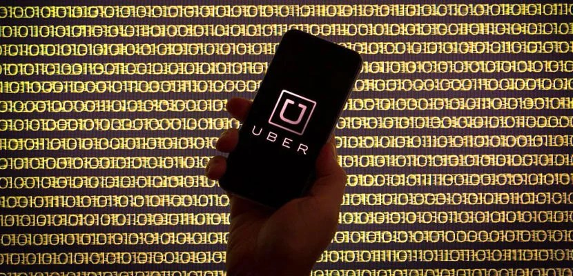 The ride sharing app Uber is seen on a smartphone in front of a binary background, in Bydgoszcz, on August 7, 2016. (Photo by Jaap Arriens/NurPhoto via Getty Images)