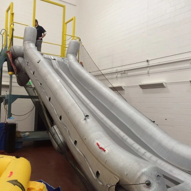 Going down the slide is a lot of fun when it's not an actual emergency.