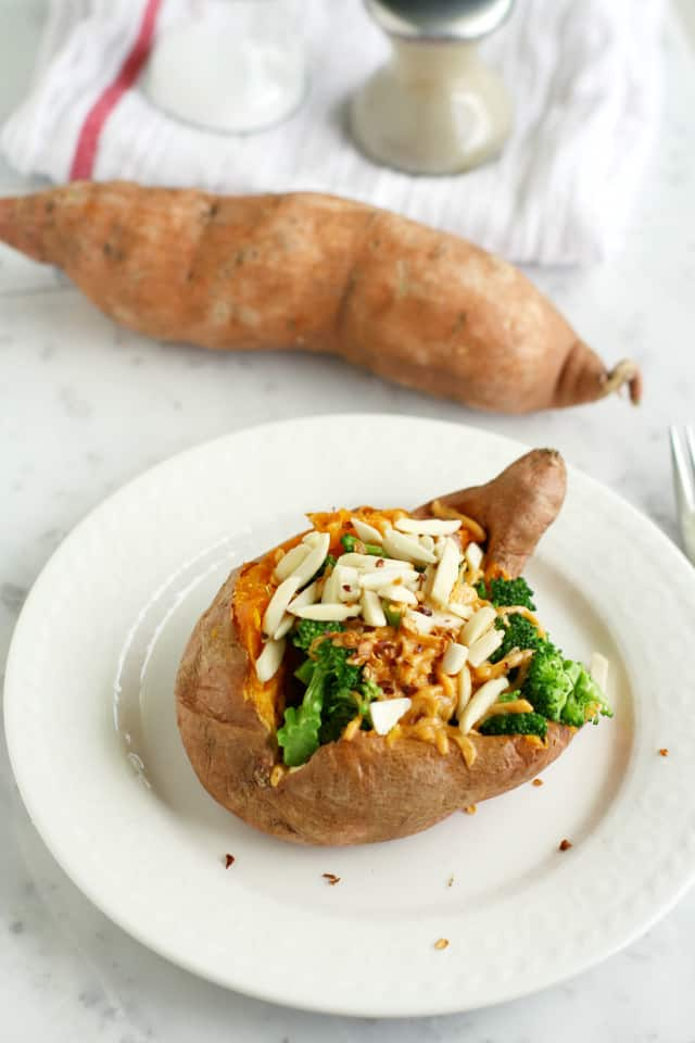 Enjoy this super healthy lunch - a sweet potato loaded with lots of healthy toppings!