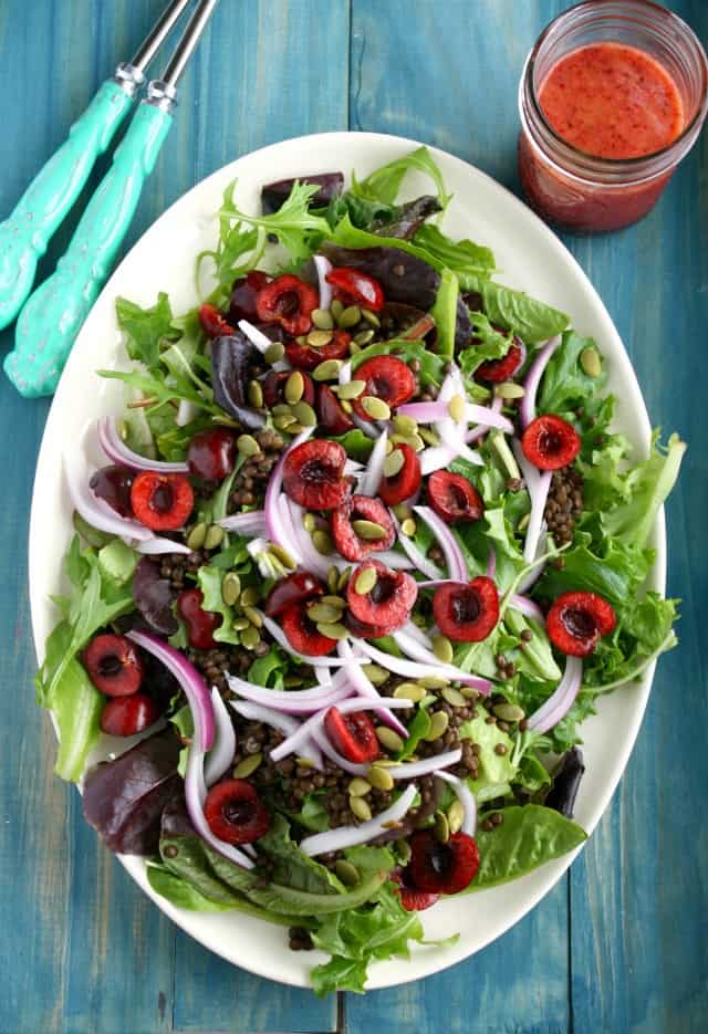 Simple and summery green salad with black lentils and fresh cherries. A sweet and tart vinaigrette finishes this healthy salad!