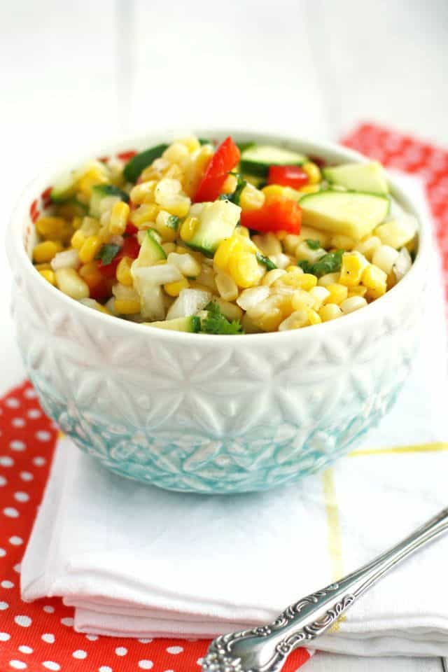 A fresh and delicious corn salad with a sweet and tangy dressing. This is a great dish for a picnic! #summer #glutenfree #corn