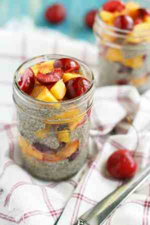 The easiest, tastiest chia seed pudding topped with peaches and cherries. The perfect summer no-cook breakfast! #chiapudding #grainfree #plantbased
