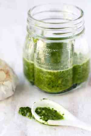 Easy and delicious nut free and dairy free pesto sauce is delicious on pasta or pizza!