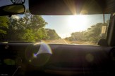 molokai travel, sunflare through windshield as we drive down highway in Jeep