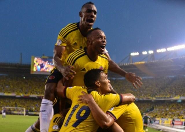 colombias_defenders_luis_amaranto_perea_top_and_juan_camilo_zuniga_c_and_forward_teofilo_gutierrez_celebrate_after_midfielder_james_rodriguez