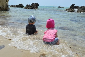 Toddlers at the beach on holiday