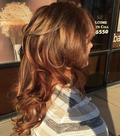 Long Layered Curly Hairstyle With Highlights