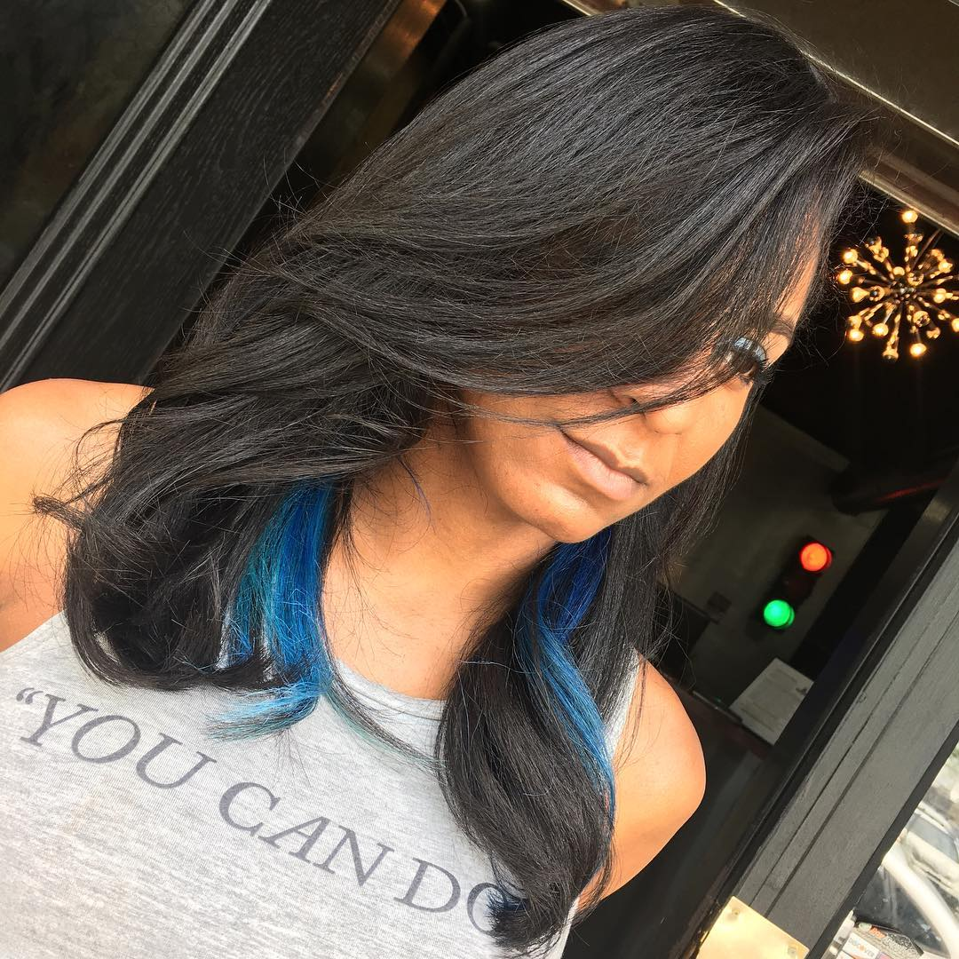 medium black hairstyle with blue highlights