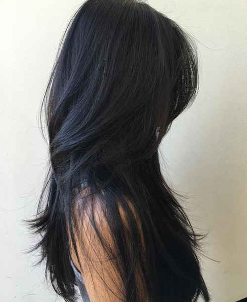 Long layered haircuts side part