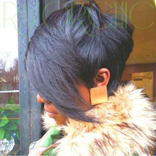 short black haircut with long side bangs