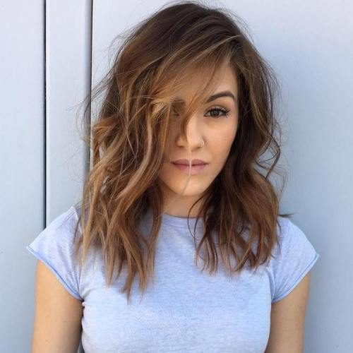 Mid-Length Messy Hairstyle With Highlights