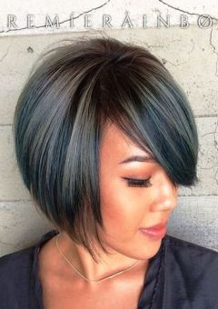 chin-length layered bob with side bangs