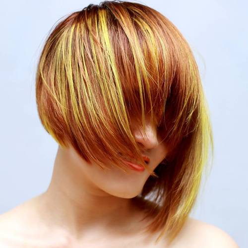 asymmetrical red bob with golden highlights