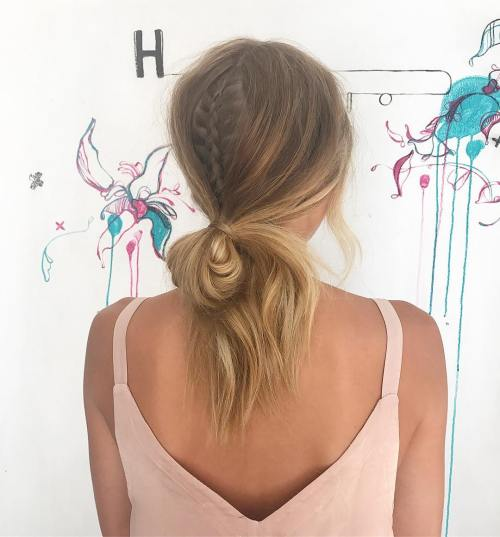 low looped ponytail with braided accent
