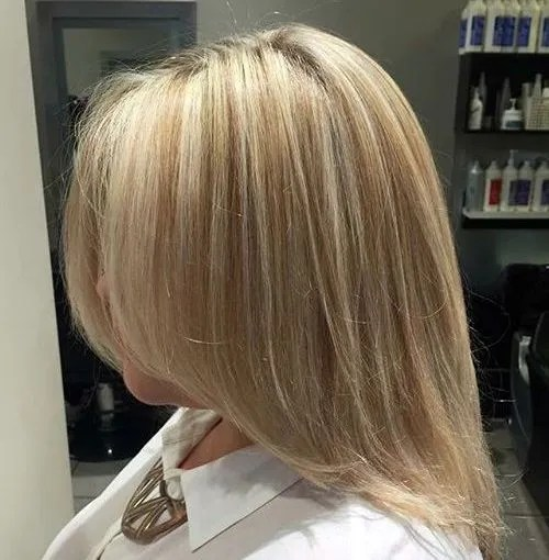 medium blonde hairstyle with subtle highlights