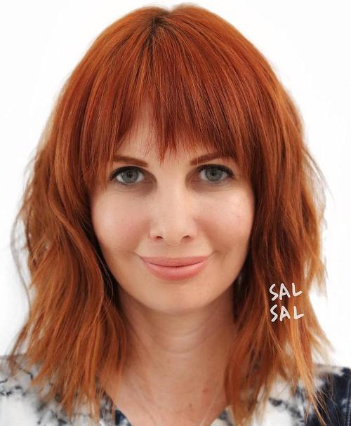shaggy red hairstyle with bangs