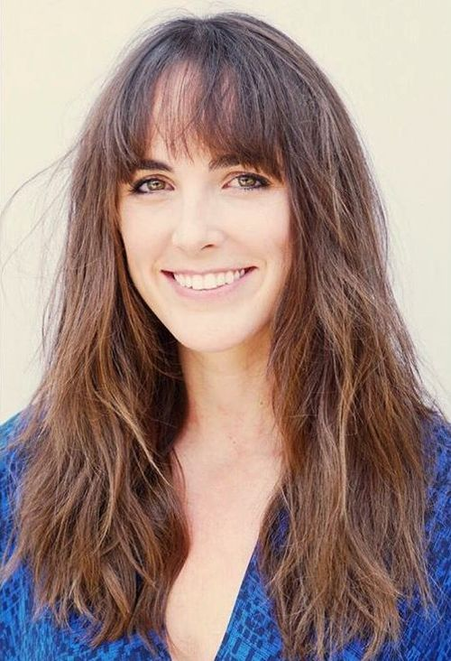 wavy layered haircut with bangs for long hair