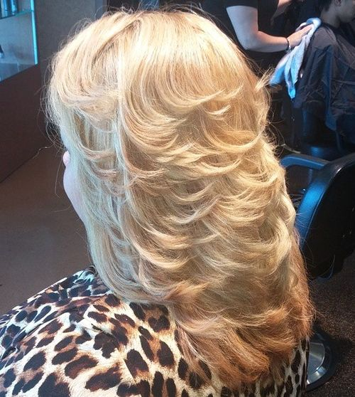 blonde layered hairstyle with flicks