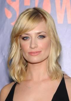 medium blonde hairstyle with bangs