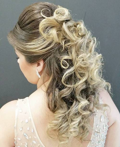 half up curly hairstyle with a bouffant