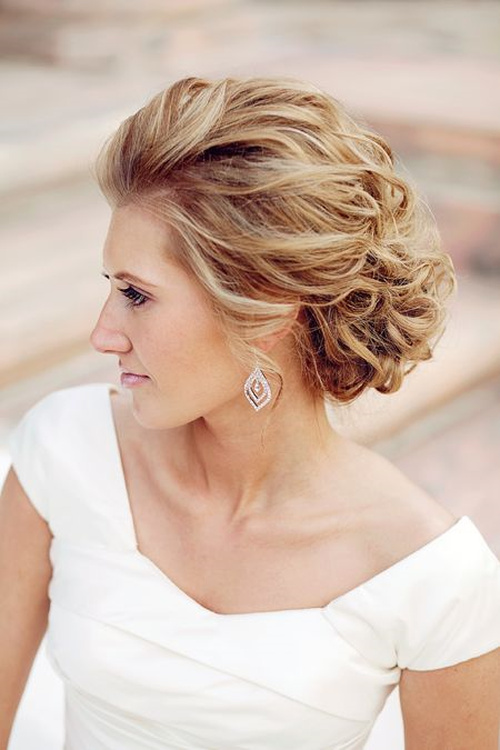 messy updo for beach wedding