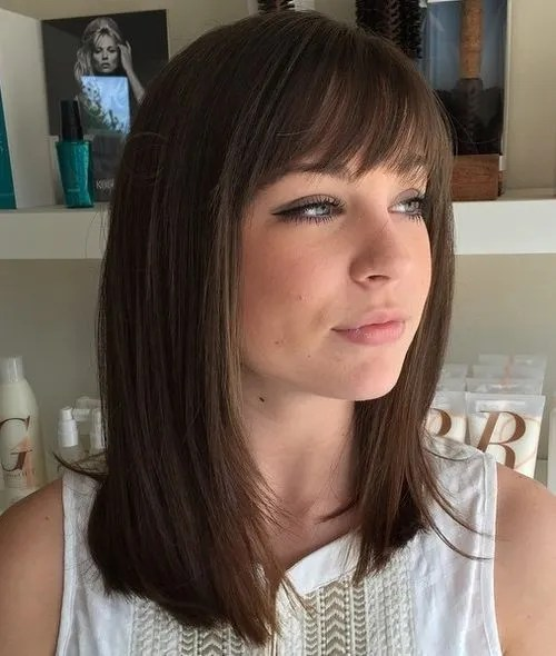 straight medium-length brunette hairstyle with bangs