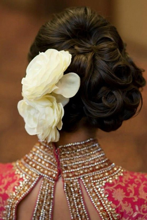 updo with flowers for Indian wedding