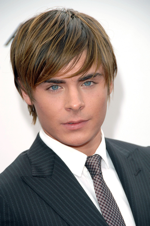 Zac Efron short to medium angled haircut