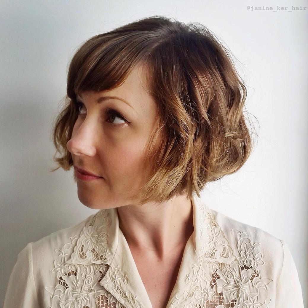 Jaw Length Curly Bob With Bangs