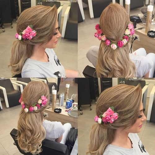 half up hairstyle with a floral headband