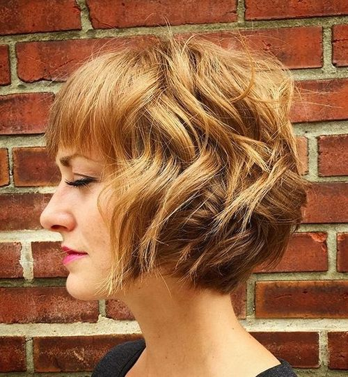 chin-length curly bob with bangs