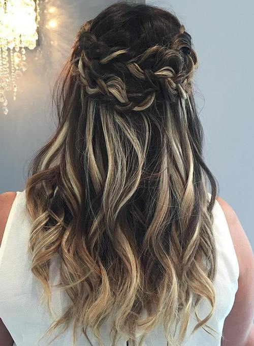 half up tousled hairstyle with a crown braid