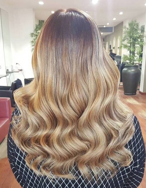 long honey blonde hair with dark roots