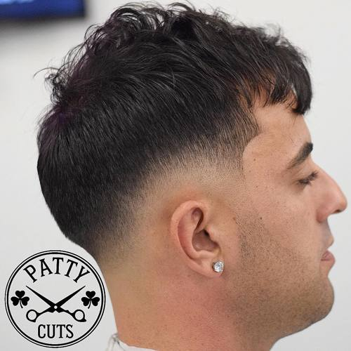 taper fade with a quiff