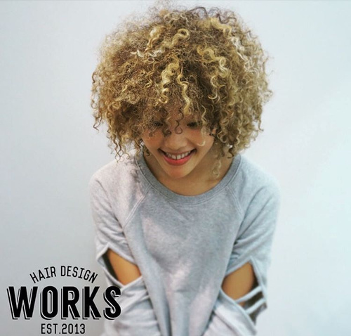 blonde perm hairstyle for teenage girls