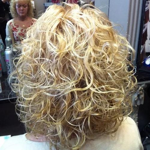 medium blonde perm hairstyle