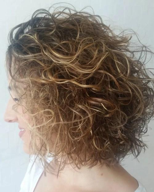 medium length dark blonde permed hair