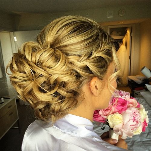 curly chignon with a side braid